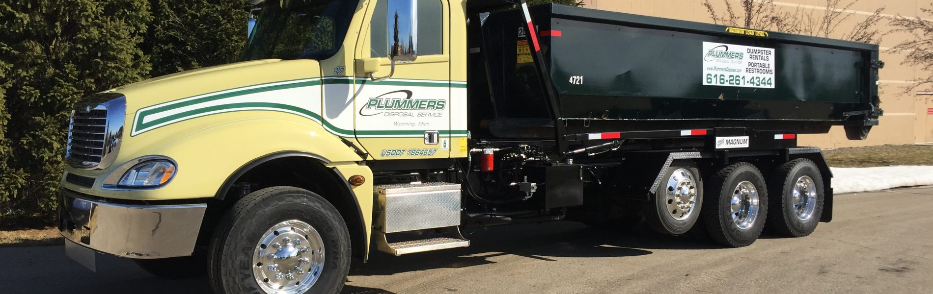 Roll Off Dumpster Truck from Plummers Disposal Services